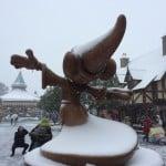 Sorcerer Mickey behind Cinderella's Castle