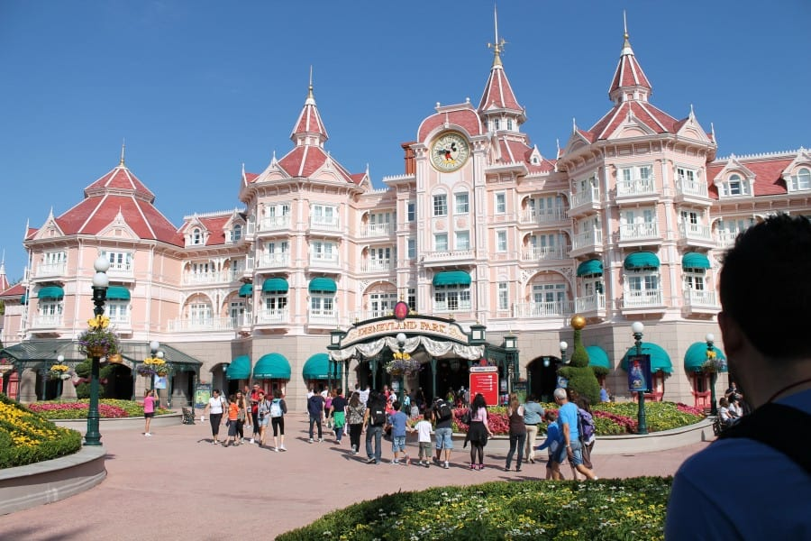 The pink stucco and red roof of Disneyland Hotel in Paris more closely resembles the architecture found at the Grand Floridian at Walt Disney World in Florida.