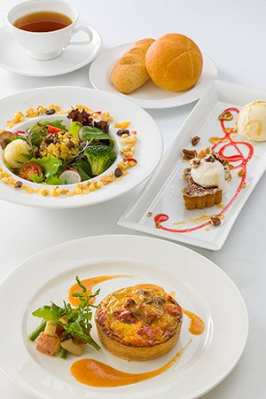 Recommended for Vegetarian's Includes Salad Vegetable and Soy Milk Quiche Pecan Nut Pie, served with Vanilla Ice Cream Soft Drink