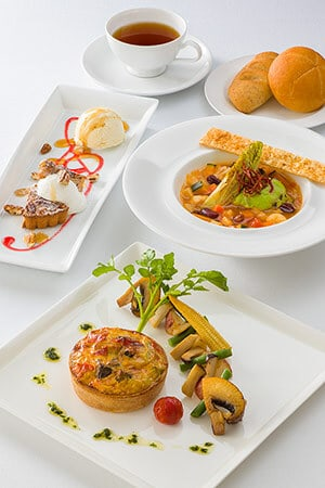 Vegetarian Combination Includes Vegetable Soup, with Green Pea Mousse Vegetable Quiche, with Vegetables Sauté and Soy Milk Bread Pecan Nut Pie with Vanilla Ice Cream Soft Drink