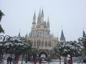 Full view of Cinderella's Castle covered in a blanket of snow.