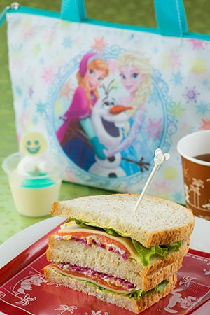 Sweetheart Cafe Special Set with Souvenir Lunch Case ¥1,820 Meal Only ¥990 Includes... *Salmon Trout and Cheese Sandwich *Orange flavored Milk Mousse *Soft Drink Available at Sweetheart Cafe