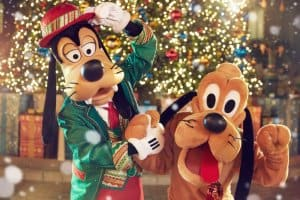 Goofy and Pluto celebrate the tree-lighting
